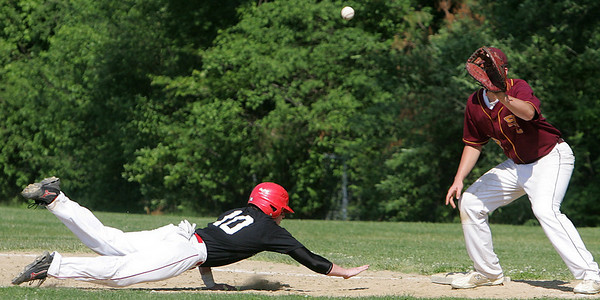 Masco's Colin Shepard slides safely back to first against Boston College High's Bobby Melley during yesterday's game held at Masco. Photo by Deborah Parker/May 25, 2010<br /> , Masco's Colin Shepard slides safely back to first against Boston College High's Bobby Melley during yesterday's game held at Masco. Photo by Deborah Parker/May 25, 2010
