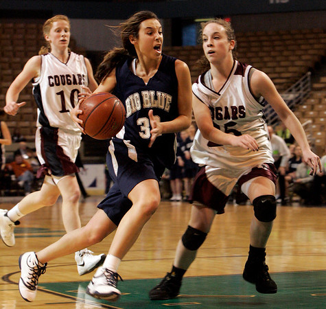 Worcester: Swampscott's Kara Gilberg is defended by Quaboag's Brianna Fleming in front of the hoop during Saturday's State Finals game held at the DCU Center in Worcester. Photo by Deborah Parker/Salem News Saturday March 14, 2009.