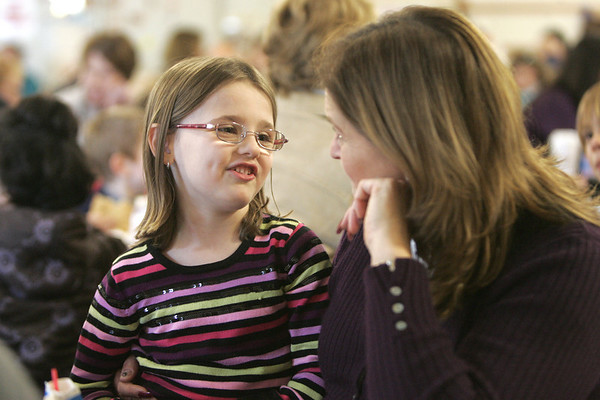 Olivia Desmond, 5, of Ipswich chats with her grandmother Joanne Sikora of Ipswich during lunch at the Doyon Elementary School. This week students were invited to bring their grandparent to lunch. Photo by Deborah Parker/november 16, 2010