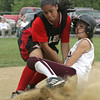 Salem's Stephania Garcia tags Chelmsford's Meghan McNamara before she can reach third base during yesterday's Division 1 North first round state trounament softball game held at Mack Park in Salem. Photo by Deborah Parker/June 3, 2010