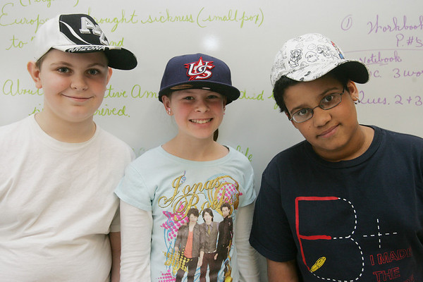 Bates School students, who typically aren't allowed to wear hats in school, had a Hats for Haiti Day at school on Tuesday. Kids and teachers could donate 50 cents to $2 to wear a hat to school with the proceeds benefiting UNICEF for Haiti relief. From left, fifth grade students Cameron McHugh Katie Walkama, and Nathaniel Mari, show off their hats. Photo by Deborah Parker/February 9, 2010