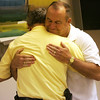 Retiring Salem police captian John Jodoin receives a hug from colleague and friend, Detective Peter Baglioni during a ceremony and luncheon at the station in Jodoin's honor in Salem Wednesday afternoon. Photo by Deborah Parker/June 30, 2010