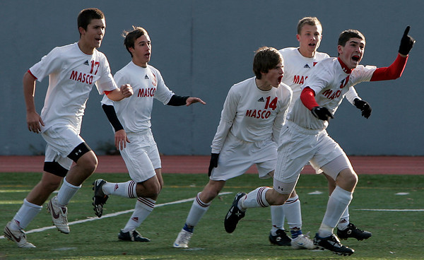 Lowell: Mark Evans celebrates after Masco scored during Saturday's Division 2 State Championship soccer game in Lowell against Mt. Greylock. Masco was defeated 3-2. Photo by Deborah Parker/Salem News Saturday, November 22, 2008.