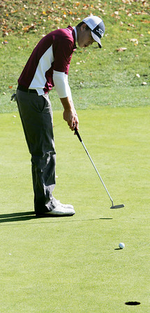 Tyler Conigliari of Gloucester puts at the second hole during the Northeastern Conference Golf Open at Tedesco Country Club in Marblehead yesterday. Photo by Deborah Parker/October 20, 2009