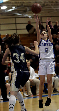 Danvers: Danvers' Erica Veilleux shoots on hoop against Wintrhop's K Mallios (no first names on roster) during yesterday's game held at Danvers High School. Photo by Deborah Parker/Salem News Friday, February 6, 2009.