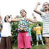 "Students from Mrs. LeBlanc's third and fourth grade class perform a dance they created to the song ""Fire Burning"" by Sean Kingston while at the school's picnic at Winter Island yesterday evening. From left are students, Marena Anderson, Kit Luster, Madison Parshley and Cara Crasco. Photo by Deborah Parker/ July 22, 2009"