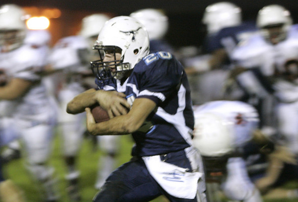 Peabody: Peabody's Nick Hiou runs through Beverly's defensive line during their game Friday night.<br /> Photo by Deborah Parker/Salem News Friday, October 10, 2008