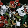 Boxford: Masconomet's Evan Bunker pushes his way through Pentucket's defensive line during last night's game held at Masco. Photo by Deborah Parker/Salem News Friday, November 7, 2008.
