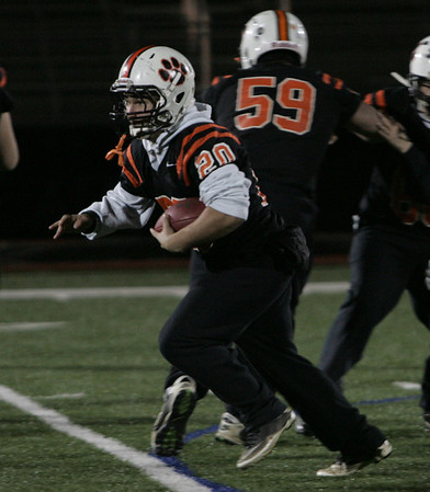 Beverly's Nick Terriault runs the ball as part of a drill during practice held at Manning Field in Lynn Monday evening. Photo by deborah parker/november 29, 2010