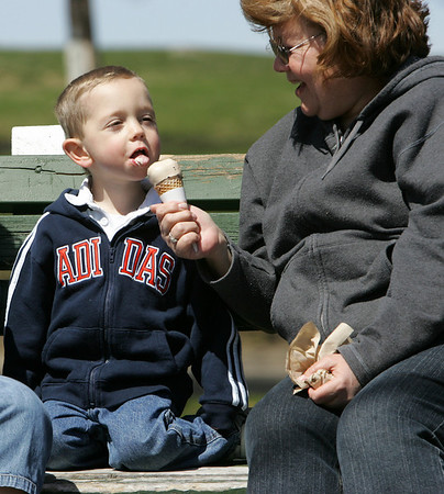 "Joey Magliozzi, 3, of Andoer shares an ice cream cone with his nana, Linda Robinson of Wilmington while at Salem Willows Park Wednesday morning. ""I used to come here all the time when I little,"" said Robinson. "" Photo by Deborah Parker/April 14, 2010"