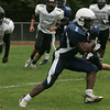 Peabody's Nathaniel Gaye runs through the Cambridge defense for a touchdown during Friday afternoon's game held at Peabody Veteran's Memorial High School. Photo by Deborah Parker/September 17, 2010