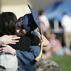 Peabody Veterans Memorial High School valedictorian Michael Ahorn hugs hig girlfriend Kathleen Monaco of Peabody after delivering his valedictory speech at graduation Friday evening. Photo by Deborah Parker/June 12, 2009