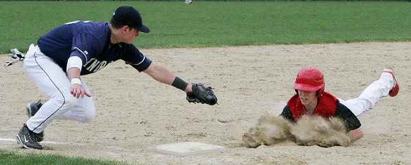 Pingree's Will Wakefield beats Masco's Corey Tudor to the plate during yesterday's game. Photo by Deborah Parker/April 12, 2010