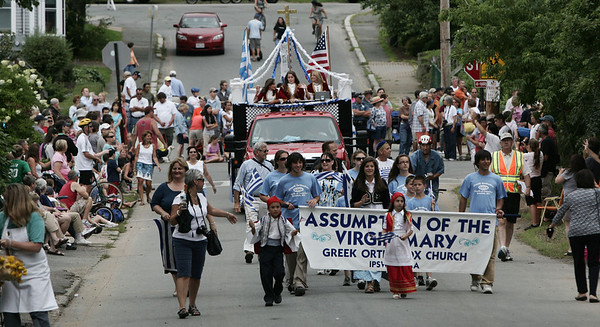 Members of the Assumption of the Virgin Mary Greek Orthodox Church march in the parade celebrating the 375th anniversary of Ipswich. The celebration included the parade, speakers, picnic and concert. Photo by Deborah Parker/August 9, 2009