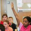 "Witchcraft Heights fifth grader Mercis Arias raises her hand to answer a question during a discussion about the book ""The Lemonade War"" by Jaqueline Davies yesterday at schoo. Photo by Deborah Parker/April 15, 2010"