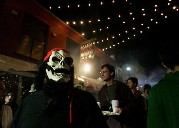 A Halloween reveler walks past the  Salem Wax Museum during Halloween evening Saturday. Photo by Deborah Parker/October 31, 2009
