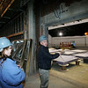 Culinary arts teacher Sue Pitman listens as Superintendent Jim Hays gives a tour of the audituorium in the new Beverly High School. Photo by Deborah Parker/January 12, 2009
