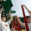 Stewart Sellars, left, and Mike Alsup, both of Beverly work on installing a section of a newly constructed playground located behind North Beverly Elementary School. This weekend volunteers including Mayor Scanlon and the company providing the equipment, UltiPlay, came together to put the playground together. Photographer Deborah Parker/August 22, 2009