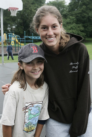 Counselor Erin Bushey and camp attendee Madison Jalbert, 9, both of Beverly, pose together while at Livingstone Park in Beverly as part of the Beverly Recreation Department Parks Program. Photo by Deborah Parker/July 21, 2009