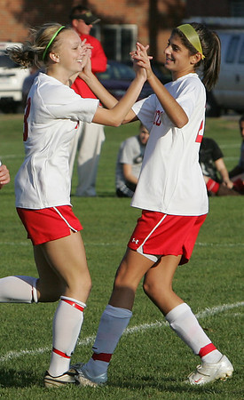 Lucy Gildein is congratulated by teammate Gabby Russo during Tuesday's game at held at Masco. Lucy will be going to play Division 1 soccer in college on scholarship. Photo by Deborah Parker/October 20, 2009