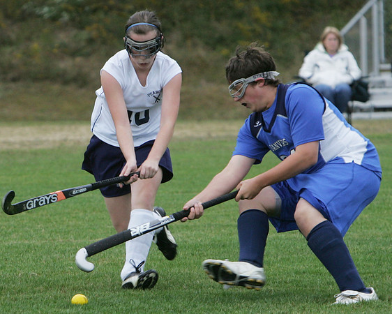 Peabody's Kate Manzi and Danvers' Seth Kamens fight for control of the ball during Wednesday afternoon's game held at Peabody Veteran's Memorial High School. Photo by Deborah Parker/September 30, 2009