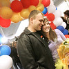 "Danvers: Engaged couple, Hadley von Bruns and Chris Johnson, both of Beverly, were ""ambushed"" with a suprise package called ""An Evening to Remember"" featuring gifts from local businesses while helping to wrap presents for Operation Troop Support at Holton Richmond Middle School Saturday. Here, the couple poses for pictures for family and friends before heading out to start their ""Evening to Remember."" Chris, who has been serving in Iraq with the Marines since Janurary of this year, returned home for a 19-day leave. Chris will return to finish his tour next week. <br /> Photo by Deborah Parker/Salem News Saturday, November 15, 2008"