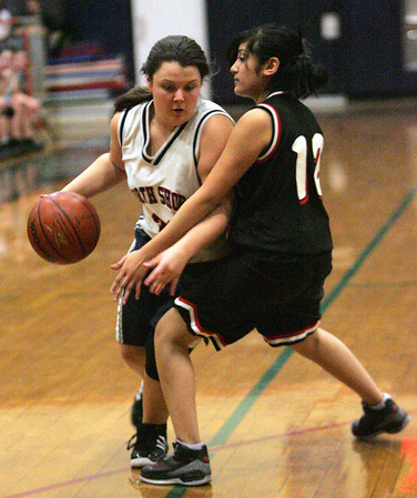 Junior point guard Heather Hicks, who is coming of an ACL injury, is defended by Madeline Vielman in a game against Chelsea. Photo by Deborah Parker/February 1, 2009