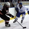 Salem: Beverly's #16 moves the puck away from a Danvers defender during yesterday's game at Salem State's Rockett Arena. Photo by Deborah Parker/Salem News Wednesday, December 17, 2008.