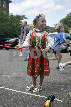 Salem: Izabella Pitman, 5, of Swampscott, giggles as she played a putting game while at St. John the Baptist Parish's Polish Festival Sunday. Traditional polish foods such as pierogi, golabki, kielbasa, kapusta were served while polka music was provided by Stop. There was also an arts and crafts table, and a dunk tank.Photo by Deborah Parker/Salem News Sunday, September 07, 2008