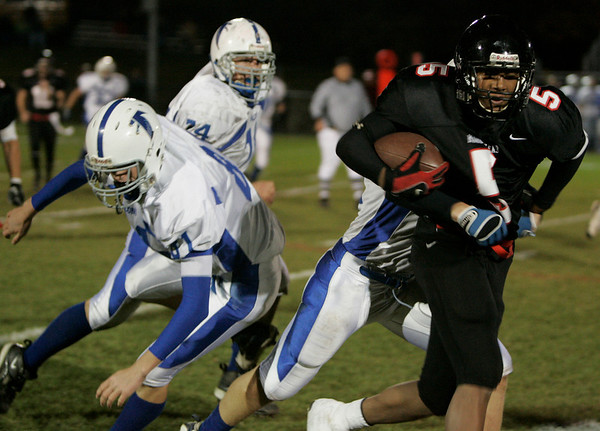 Marblehead: Marblehead's Taariq Allen is brought down by a Danvers defender during last night's game at Marblehead. Photo by Deborah Parker/Salem News Thursday, October 24, 2008.