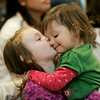Hamilton: Holly Dawson, 2, of Rowley gest a big kiss from her older sister, Annabelle while attending the Joint Library's Mardi Gras Extravaganza Wednesday afternoon. Photo by Deborah Parker/Salem News Wednesday, February 18, 2009.
