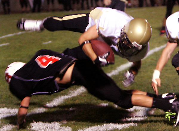 Bishop Fenwick's Chris Renzulli is tackled by Salem's Nate Staples during Friday night's game held at Bertram Field. Photo by Deborah Parker/September 18, 2009