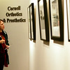 Double Vision, a show by David Piemonte and his wife, Terry Del Percio-Piemonte is showing at the Centennial Gallery at The Musculoskeletal Center in Peabody. Here Natalie Chatel of Lexington examines Piemonte's photographs. Photo by Deborah Parker/November 23, 2009