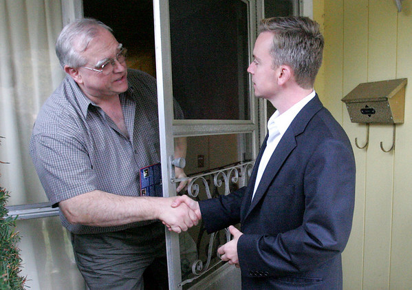 Mayoral candidate John Burke greets Beverly resident Bill Bunker while making once last canvas of a Centerville neighborhood on  the final day of campaigning in the Beverly mayor's race.  Photo by Deborah Parker/November 2, 2009