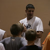 St John's Prep Steve Connolly leads a youth basketball clinic at the Shore County Day School in Beverly Monday evening. Photo by Deborah Parker/October 4, 2010