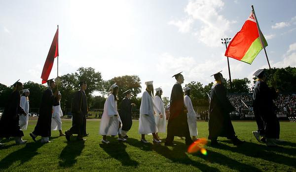 Graduating seniors march out onto the football field during Peabody Veterans Memorial High School graduation ceremony Friday evening. Photo by Deborah Parker/June 4, 2010