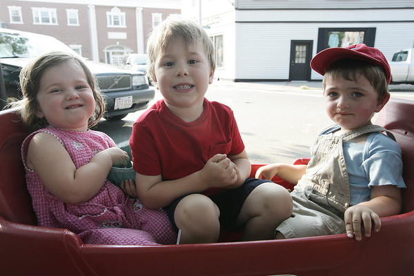 From left, Magnolia, 2, and Miles Rand, 4, along with neighbor, Carmen McCarthy, 1, all of Beverly munch on snacks from the Beverly Farmers Market Monday afternoon. Photo by Deborah Parker/August 17, 2009