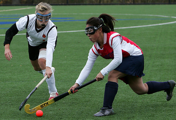 Beverly's Julie Crowely and Brookline's Michelle Li fight for control of the ball during the Division 1 North first round tournament field hockey game held at Salem State College Thursday afternoon. Photo by Deborah Parker/November 5, 2009