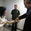 Essex Agricultural High School senior Laura Tarazona of Lynn laughs after the ferret she was holding tried to climb up the coat sleeve of Governor Deval Patrick while he was touring the school Friday morning. Photo by Deborah Parker/December 11, 2009