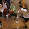 Matthew Heckman of Gloucester runs through a dribbling drill during a youth basketball clinic at the Shore County Day School in Beverly Monday evening. Photo by Deborah Parker/October 4, 2010