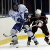 Salem: Beverly's #11 fights for control of the puck against Danvers' Kyle Larson during yesterday's game at Salem State's Rockett Arena. Photo by Deborah Parker/Salem News Wednesday, December 17, 2008.