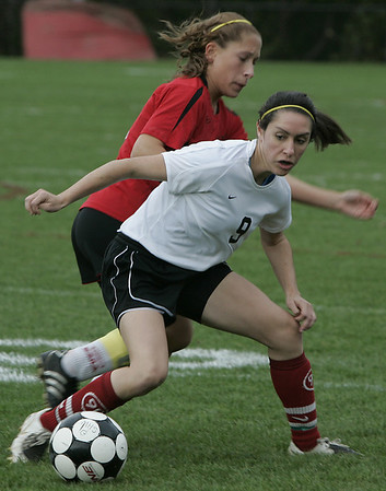 Marblehead:Marblehead's Mary KGorack keeps the ball away from Salem's Meghan Willians during yesterday's game at Marblehead.<br /> Photo by Deborah Parker/Salem News Friday, October 03, 2008