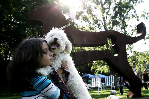 Zehava Younger, 9, of Beverly dances with her dog, Chili, during the Big Dog Show at Beverly Common yesterday afternoon. Photo by Deborah Parker/Septmeber 3, 2009