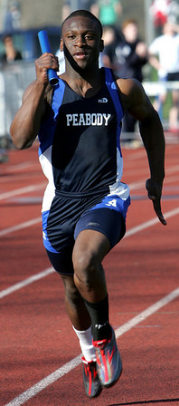 Peabody's Nat Gaye competes in the 4 by 1 relay during yesterday's meet against Gloucester held at Peabody High School. Photo by Deborah Parker/April 5, 2010