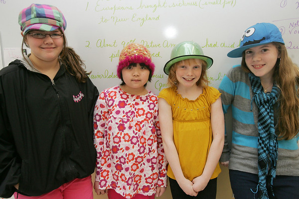 Bates School students, who typically aren't allowed to wear hats in school, had a Hats for Haiti Day at school on Tuesday. Kids and teachers could donate 50 cents to $2 to wear a hat to school with the proceeds benefiting UNICEF for Haiti relief. From left, fifth grade students Brianna Swan, Vivian Le, Isadora Thesz, and Holly Bartlett, show off their hats. Photo by Deborah Parker/February 9, 2010