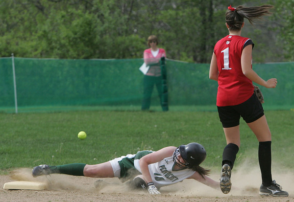 Pentucket's Cassandra Koegel slides safely into second at Masco's Olivia Story looses control of the ball during yesterday's game. Photo by Deborah Parker/may 7, 2010