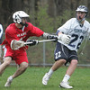 Hamilton Wenham's #22  ___ is defended by Masco's Nate Webster during yesterday's game held at Hamilton Wenham High School. Photo by Deborah Parker/April 16, 2010