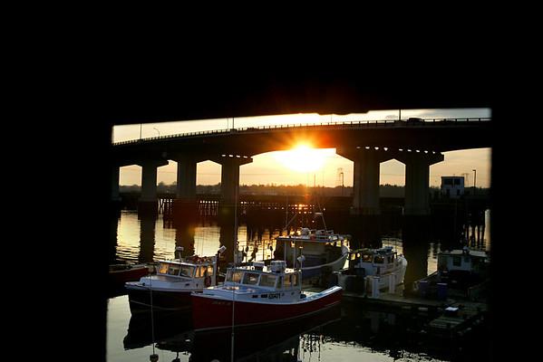 The sun shines through the Veterans Memorial Bridge late Tuesday afternoon. Photo by Deborah Parker/December 15, 2009