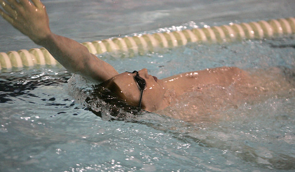 Robert Breen of the St. John's swim team works through a drill at an early morning practice at the Danvers YMCA Wednesday morning. photo by deborah parker/decemeber  7, 2010