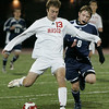 Reading: Masco's Steve Perkins keeps the ball from Wilmington's James Marra during MIAA tournament action in Readying last night. Masco beat Wilimington 1-0 in double overtime. Photo by Deborah Parker/Salem News Thursday, Novemebr, 13, 2008.